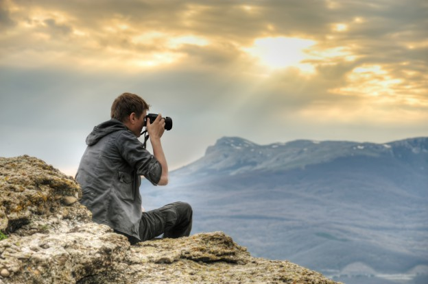 Photographer on mountainside