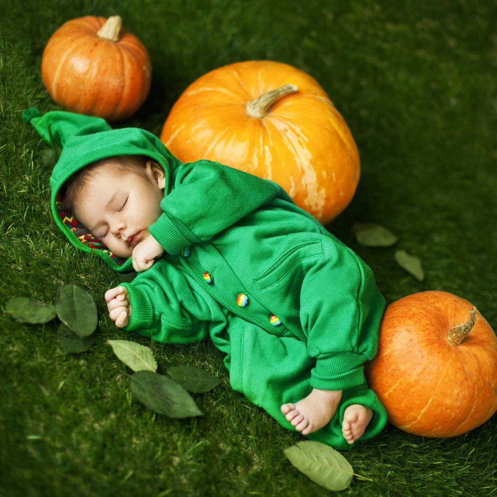 A sleeping baby in a peapod blanket