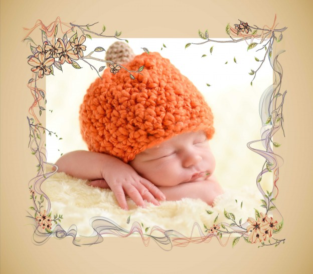 Baby in pumpkin hat